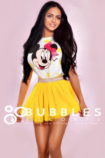 Roxanna showing a bright smile in minnie the mouse top and yellow skirt